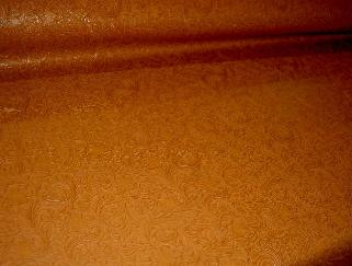 Angle view of Faux Tooled Etched Leather by the yard pattern Laredo Upholstery Vinyl Fabric Color Pottery