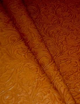 Draped image of Faux Tooled Etched Leather by the yard pattern Laredo Upholstery Vinyl Fabric Color Pottery